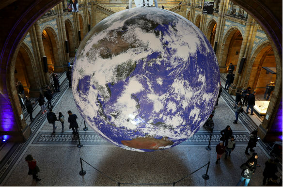 A giant Earth artwork is displayed in the Hintze Hall inside the Natural History Museum in London, Britain on November 30, 2018. Simon Dawson/Reuters