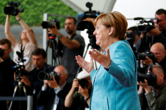 German Chancellor Angela Merkel reacts as she receives guests at the Chancellery in Berlin, Germany, June 29, 2017. (Fabrizio Bensch/Reuters)