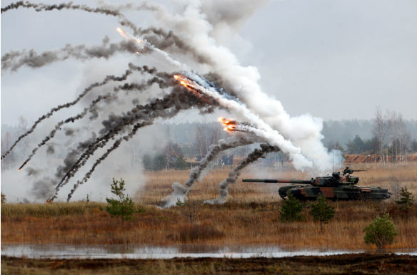 Polish Army PT-91 tank is seen during Silver Arrow 2017, the multinational military drills involving eleven NATO member countries in Adazi, Latvia on October 29, 2017. (Ints Kalnins/Reuters)