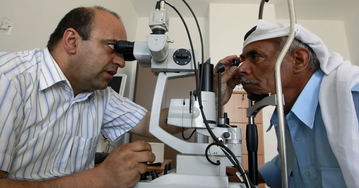 A Palestinian doctor examines a patient's eyes at a medical center in a refugee camp in the West Bank town of Bethlehem, on May 7, 2012. Ammar Awad/Reuters