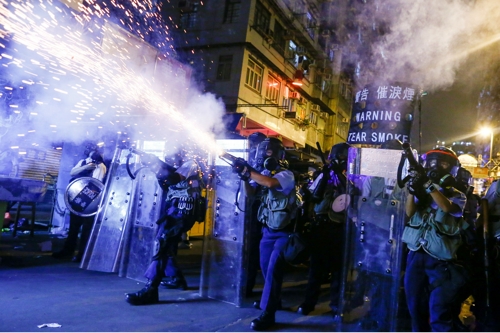 Police fire tear gas at anti-extradition bill protesters during clashes in Sham Shui Po in Hong Kong, China, on August 14, 2019. REUTERS/Thomas Peter