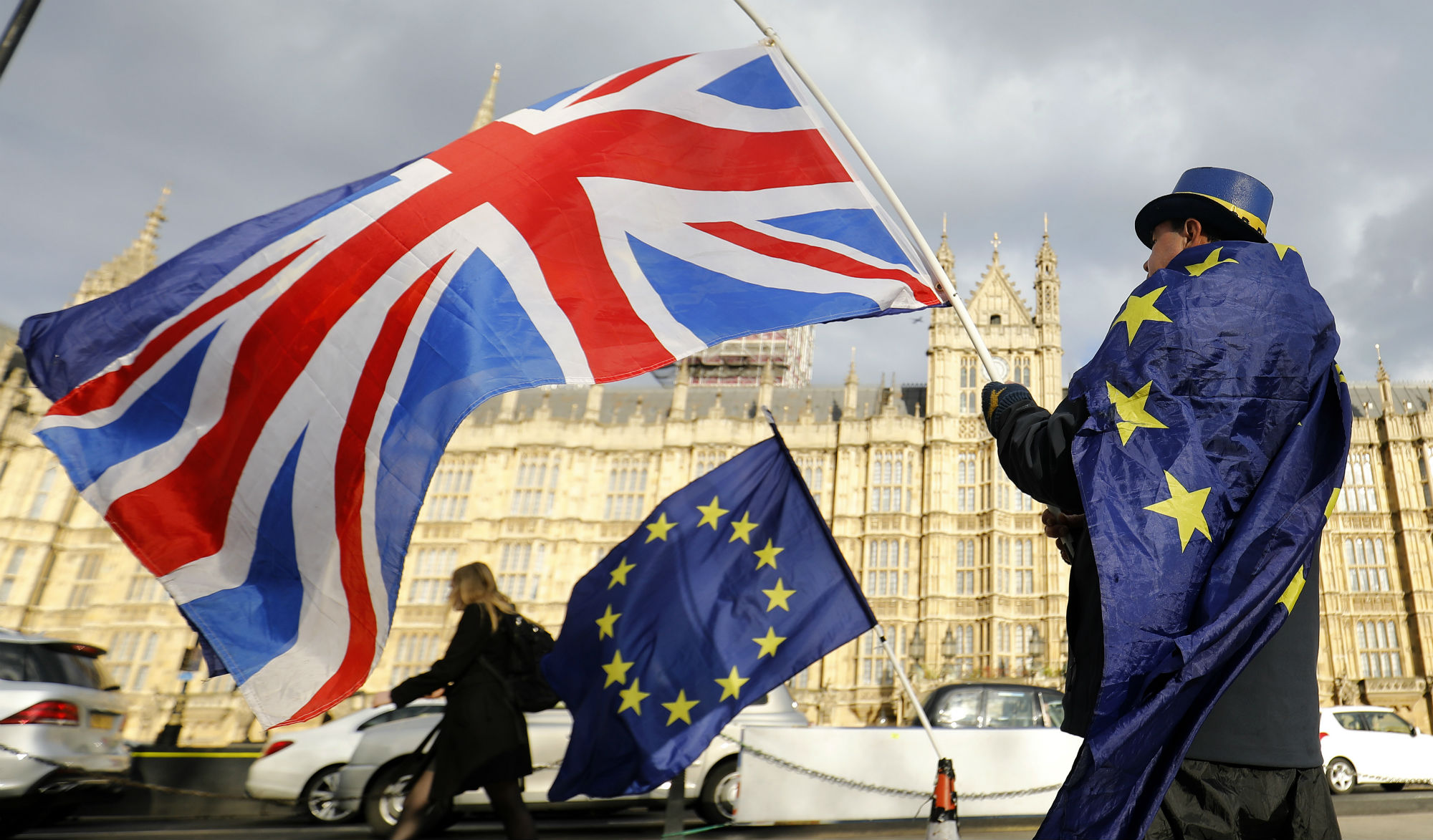 An anti-Brexit demonstrator waves a Union flag alongside a European Union flag outside the Houses of Parliament in London on March 28, 2018. Tolga Akmen/AFP via Getty Images